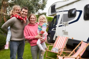 Portrait Of Family Enjoying Camping in an RV