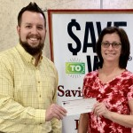 Willa receiving her check from New Castle Branch Manager Brad Brewer