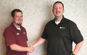 New Richmond Branch Manager Tyler Webb shakes hands with the outgoing Branch Manager Jason Burdette who has accepted the job of VP of Member Services.